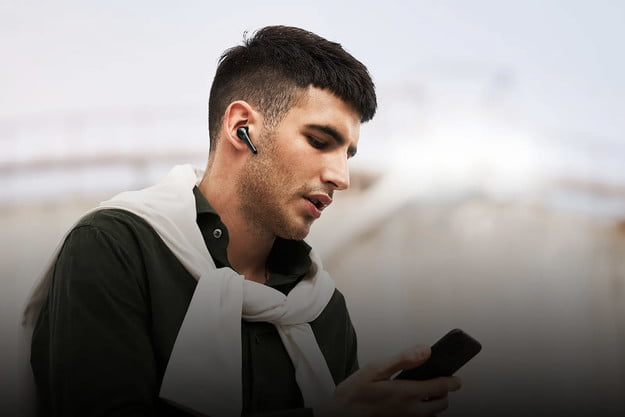 man on phone wearing 1more comfobuds pro