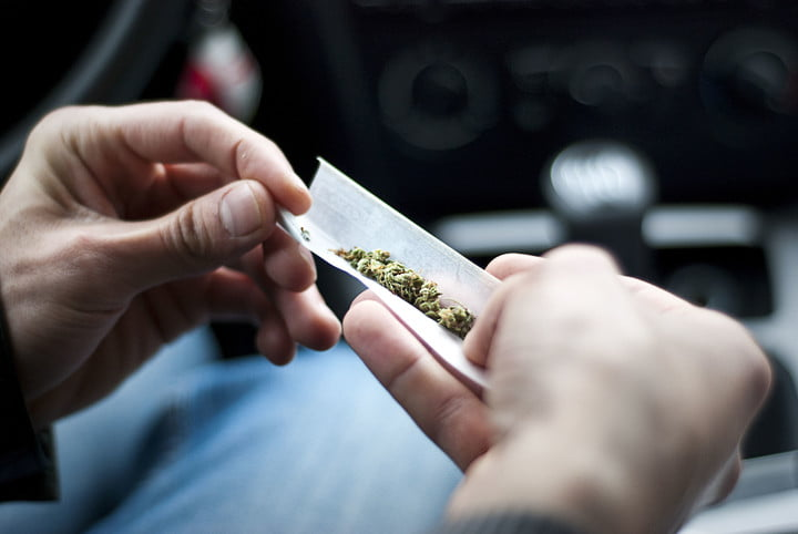 dea synethetic marijuana safer than weed 59953123  man making joint and a stash of in the car