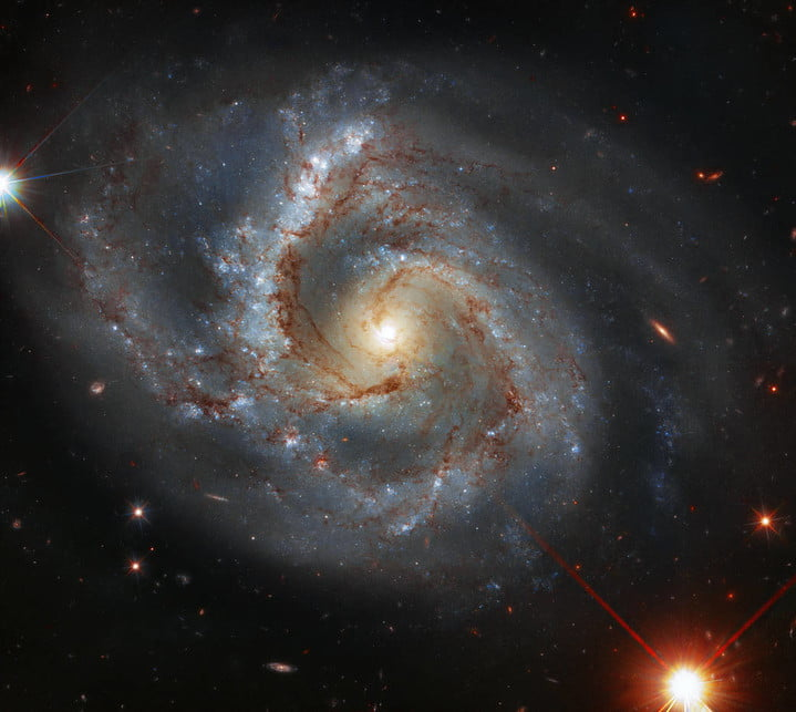 This image taken with the NASA/ESA Hubble Space Telescope features NGC 7678 – a galaxy with one particularly prominent arm, located approximately 164 million light-years away in the constellation of Pegasus (the Winged Horse). With a diameter of around 115,000 light-years, this bright spiral galaxy is a similar size to our own galaxy (the Milky Way) and was discovered in 1784 by the German-British astronomer William Herschel.