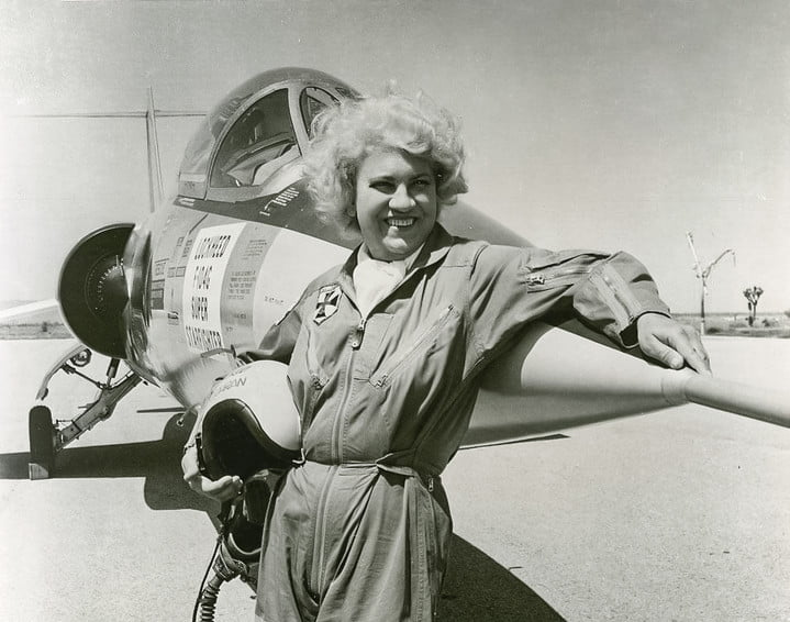 Jacqueline Cochran standing outside of a P-40 Warhawk Fighter Plane