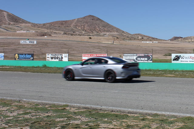 2015 dodge charger challenger srt hellcats track review and hellcat on side
