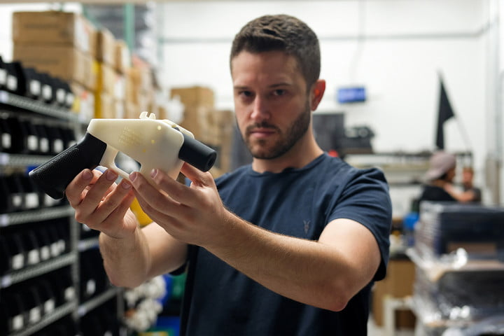 Cody Wilson, owner of Defense Distributed company, holds a 3D printed gun