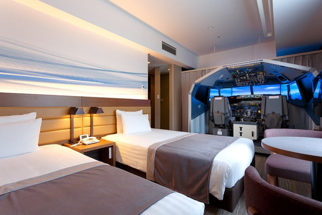 airport hotel builds a full size flight simulator into guest room  1