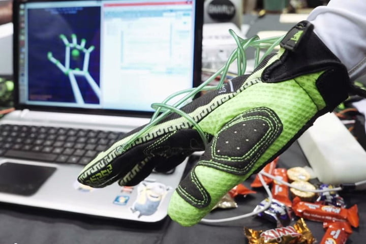 this glove uses air to let you feel digital objects in virtual reality hands omni vr touch rice university