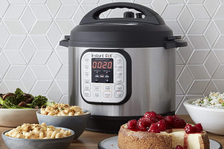 Instant Pot Duo on counter with cheescake and other dishes