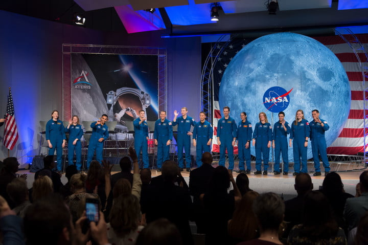 NASA's new class of astronauts – the first to graduate since the agency announced its Artemis program – appear on stage during their graduation ceremony at the agency's Johnson Space Center in Houston on Jan. 10, 2020.