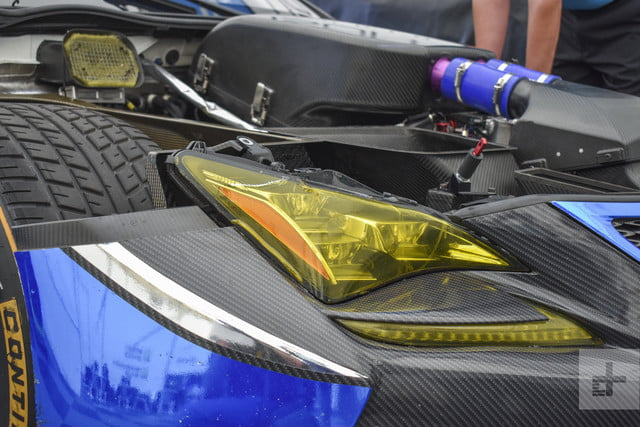 Close up detail shot of the Lexus RC F GT3 showing off the front right headlight and engine