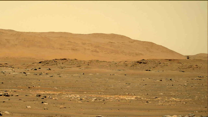 NASA's Mars Perseverance Rover captured this image of the Ingenuity Mars Helicopter (top right) with its left Mastcam-Z camera.  Mastcam-Z is a pair of cameras located high up on the rover mast.  This is a still image from a sequence captured by the camera while the video was being recorded.  This image was taken on April 30, 2021 (Sol 69) at the local mean solar time of 12:33:27.