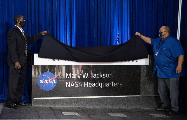 Bryan Jackson, grandson of Mary W. Jackson, left, and Raymond Lewis, son-in-law of Mary W. Jackson, right, unveil the Mary W. Jackson NASA Headquarters sign during a ceremony officially naming the building, Friday, Feb. 26, 2021, at NASA Headquarters in Washington, DC. Mary W. Jackson, the first African American female engineer at NASA, began her career with the agency in the segregated West Area Computing Unit of NASA's Langley Research Center in Hampton, Virginia. The mathematician and aerospace engineer went on to lead programs influencing the hiring and promotion of women in NASA's science, technology, engineering, and mathematics careers. In 2019, she posthumously received the Congressional Gold Medal.