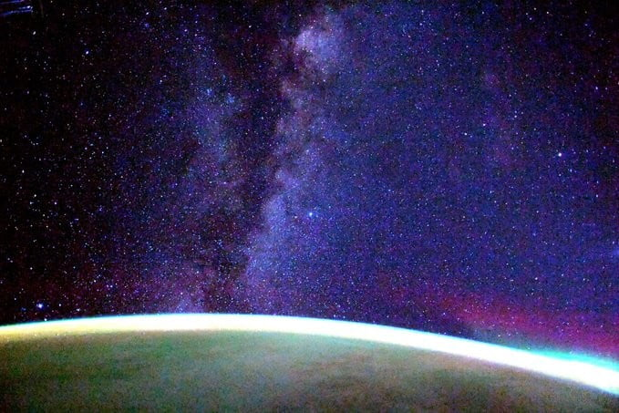 milky way and earth feature in stunning space station photo from crew dragon