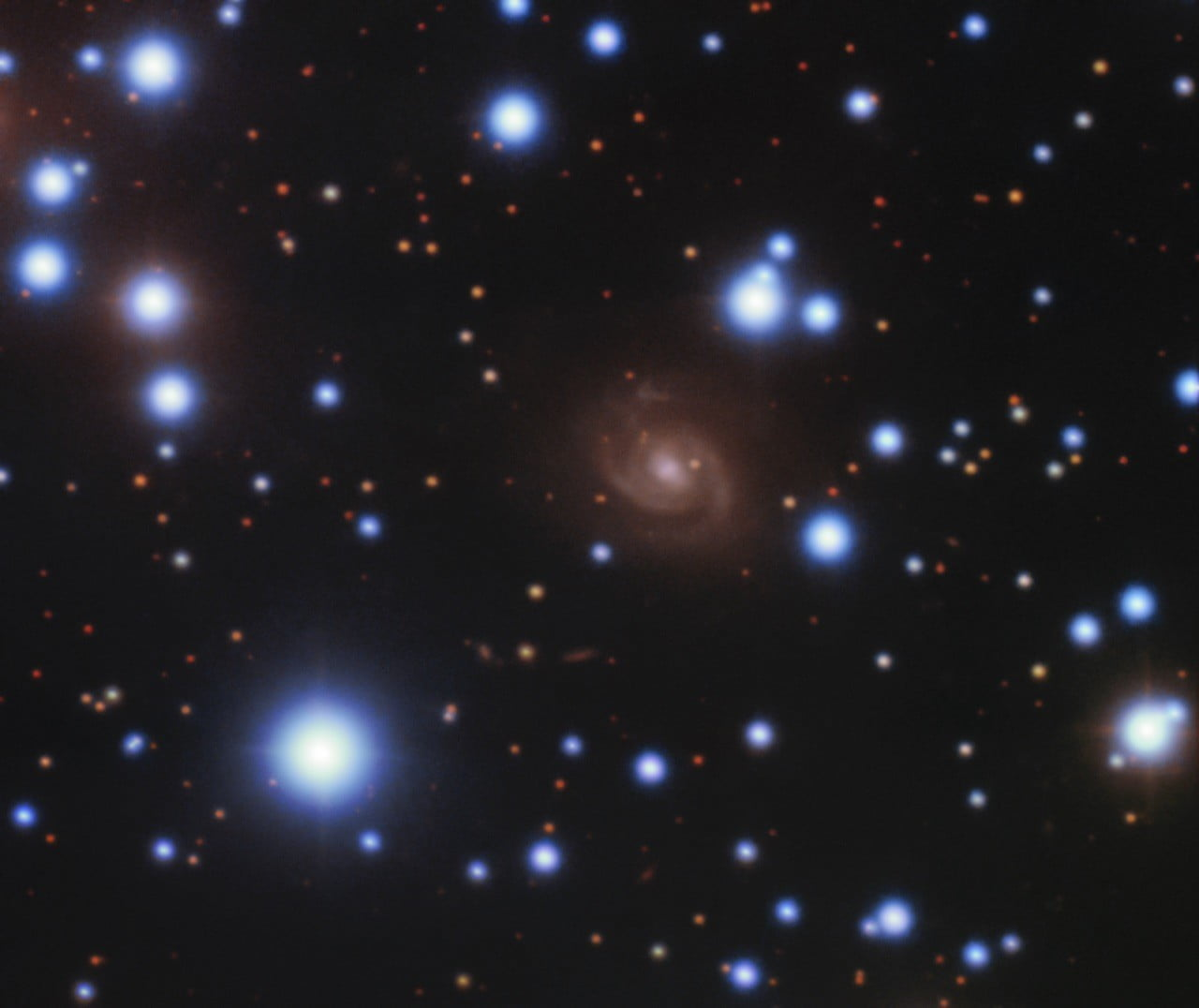 Image of the host galaxy of FRB 180916 (center) acquired with the 8-meter Gemini-North telescope of NSF's OIR Lab on Hawaii's Maunakea.