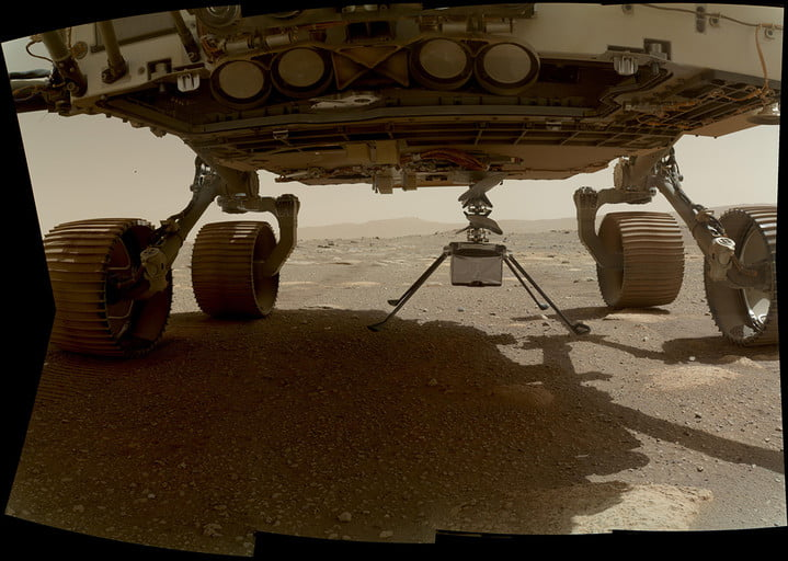 NASA's Ingenuity helicopter can be seen here with all four of its legs deployed before dropping from the belly of the Perseverance rover on March 30, 2021, the 39th Martian day, or sol, of the mission.