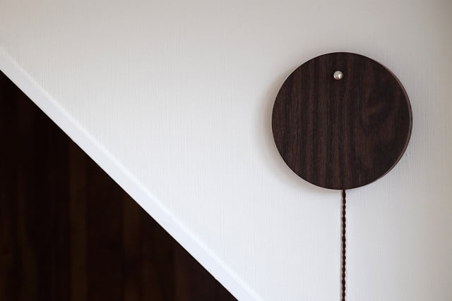 flyte story levitating clock walnut wall