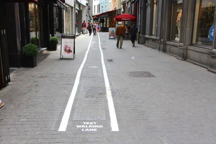 belgian city launches text walking lanes for smartphone addicts lane belgium