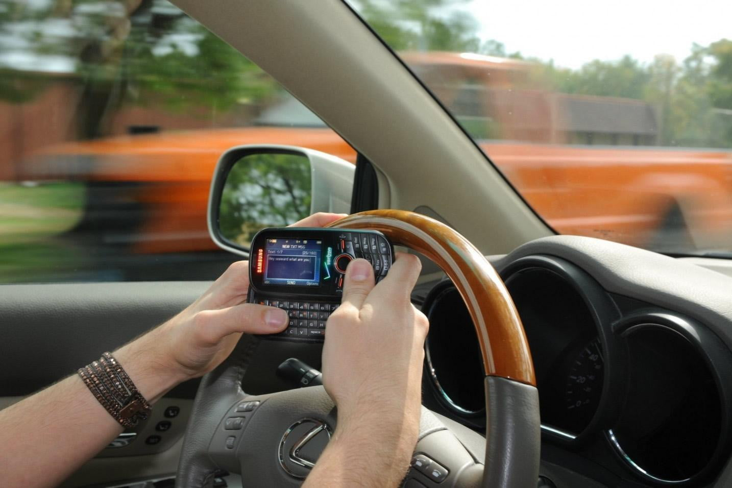 texting while driving in a Lexus