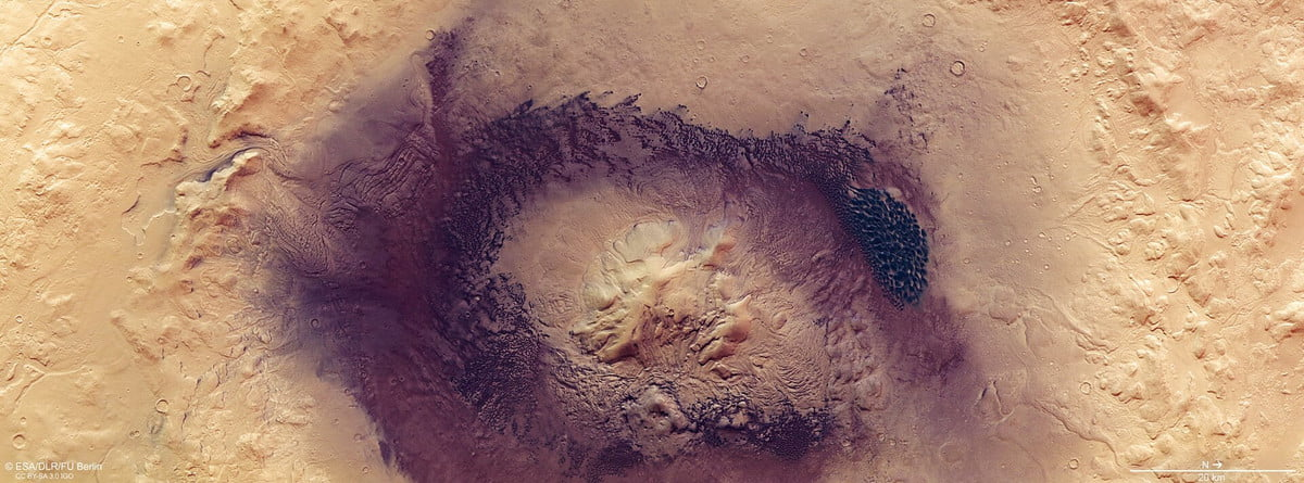 Known for its wide swathes of rippling, textured, gently sloping dunes, Mars' Terra Sabaea region is home to many fascinating geological features – including the prominent Moreux crater, the star of a new image from ESA's Mars Express.