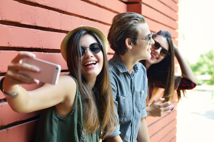 finstagram fake instagram young people having fun outdoor and making selfie with smart pho
