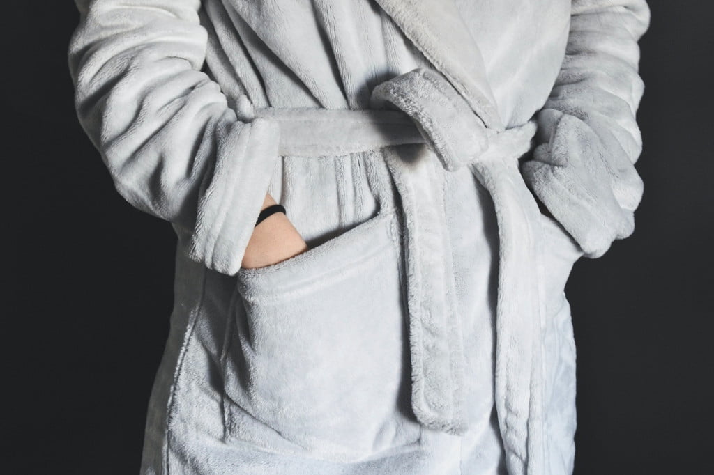 Person wearing griffin robe with hands in pockets