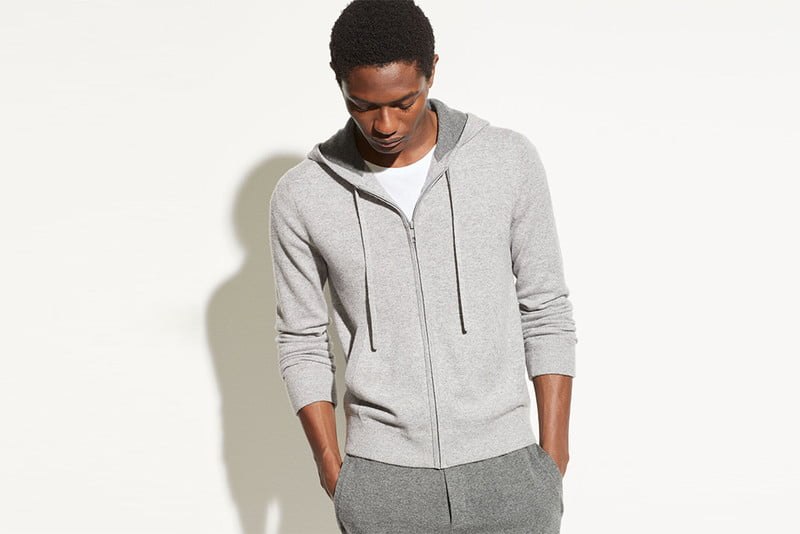 Man wearing a grey cashmere hoodie and sweatpants.