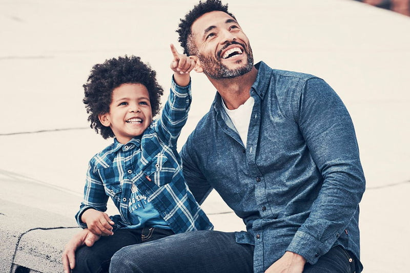 A father and son dressed handsomely in Amazon essentials.