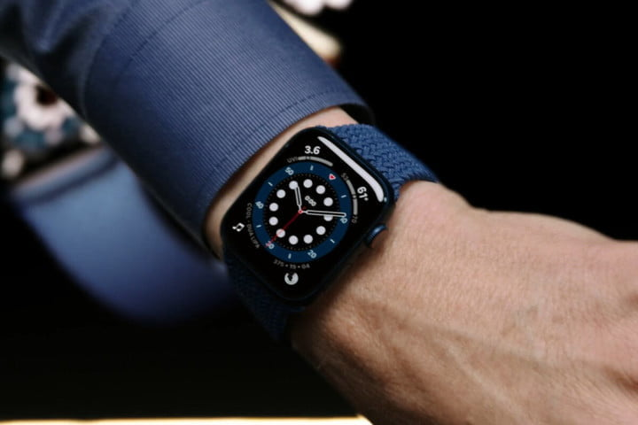 Apple Watch Series 6 worn by distinguished professional in suit.