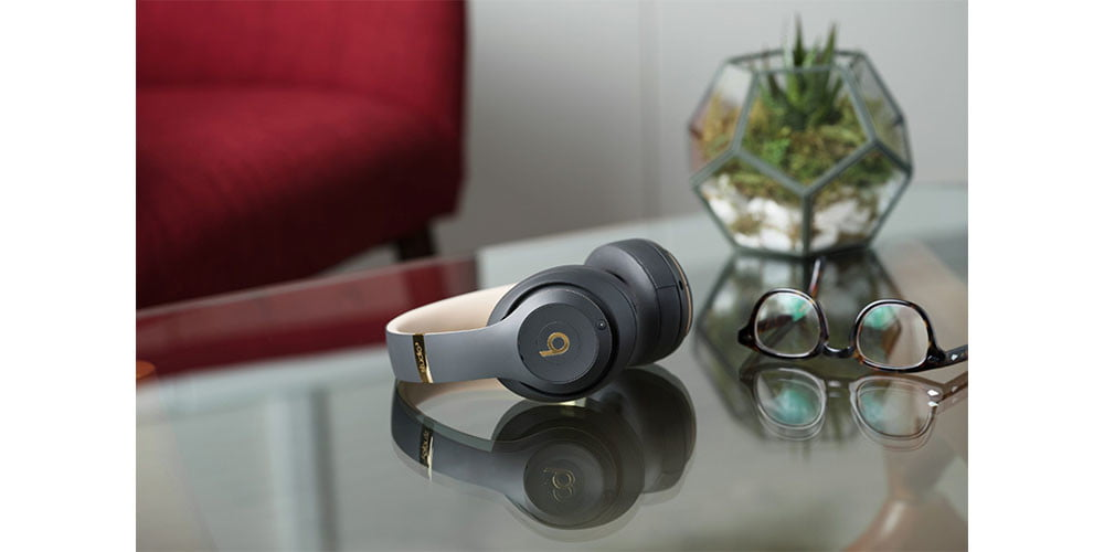 Beats Studio 3 Wireless Noise Cancelling Headphones placed on a countertop with a plant nearby.