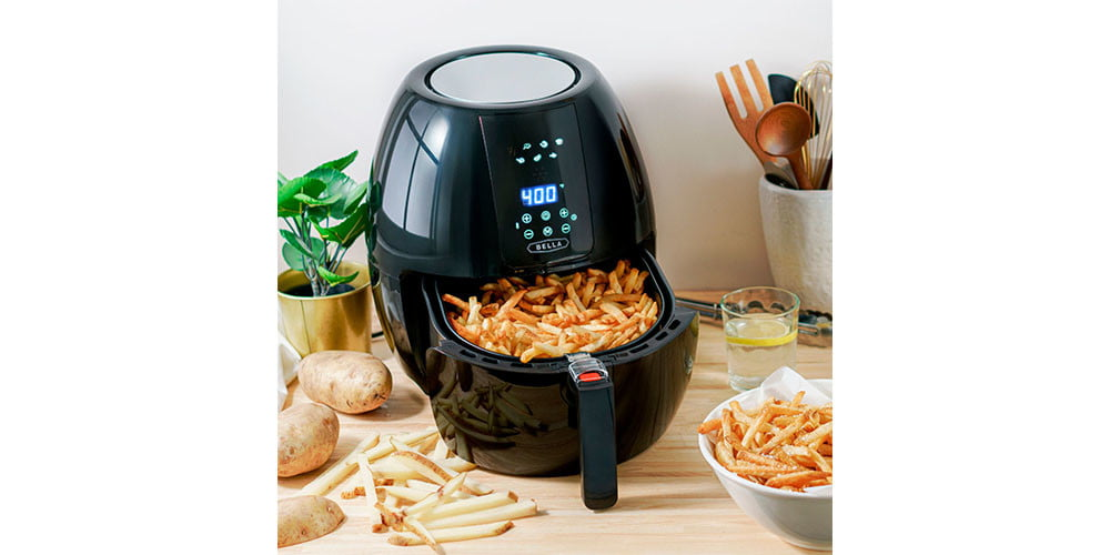 Bella 5.4-quart Air Fryer on a kitchen countertop with fries in the frying container.