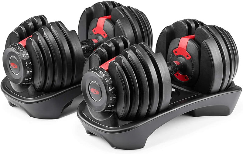 Bowflex SelectTech adjustable dumbbells sitting in their stand case on a white background.