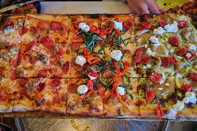 Whole Roman style Pizza al taglio with various toppings